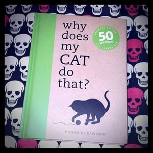 Why Does My Cat Do That? Hardcover Book
